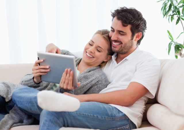 In love couple using a tablet computer